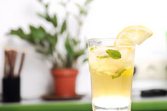 Glass of lemonade with a slice of lemon and mint Royalty Free Stock Photo