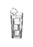 Glass of lemonade soda drink cold with ice cubes Stock Image