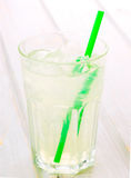 Glass of lemonade with straw on wood Royalty Free Stock Photography