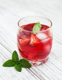 Glass of lemonade with strawberries Stock Image