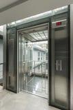 Glass lift. Door opened modern glass elevator Stock Image