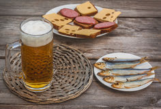 A glass of light beer on a background of snacks. Selective focus Royalty Free Stock Image