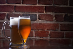 Glass of light beer on a dark pub. Background with Glass of light beer on a dark pub royalty free stock photo