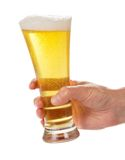Glass of light beer in hand Royalty Free Stock Photography