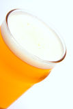 Glass of light beer isolated. On a white background royalty free stock photography