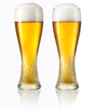 Glass of light beer isolated on white. Clipping path Stock Photography