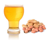 Glass of light beer and peanuts Royalty Free Stock Photography