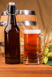 Glass of light beer and spikes of barley Stock Image