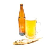 Glass of light beer and stockfish closeup Royalty Free Stock Photo