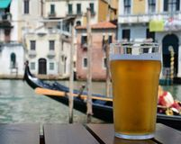 Glass of light beer in Venice Royalty Free Stock Photo