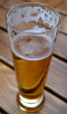 Glass of light beer. On a wooden table Royalty Free Stock Image