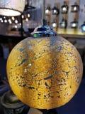 Glass light bulb. Yellow mosaic glass light bulb Stock Images