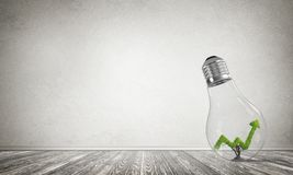 Concept of effective marketing innovations. Glass lightbulb with growing green arrow graph inside in empty room with grey wall on background. 3D rendering Royalty Free Stock Images