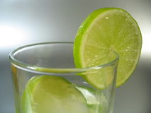 Glass with Lime. A glass with lime slices Stock Images