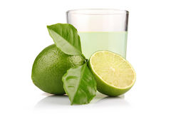 Glass of lime juice and lime fruits isolated Stock Photos