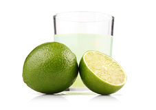 Glass of lime juice and lime fruits isolated Royalty Free Stock Image