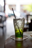 Glass of Lime Soda with ice cubes on a cafe table Royalty Free Stock Photos