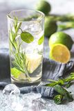 Glass of lime water with herbs royalty free stock photo
