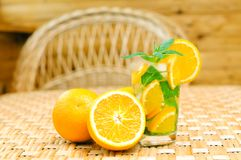 Glass of limonade with oranges Royalty Free Stock Photo