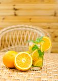 Glass of limonade with oranges Stock Image