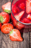 Glass with Liqueur and fresh fruits Stock Photography