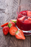Glass with Liqueur and fresh fruits Royalty Free Stock Photos