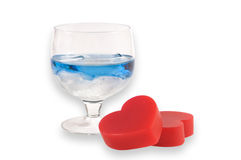 A glass of liqueur with two hearts. Stock Image