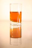 Glass of liquor on brown gradient background Royalty Free Stock Photo