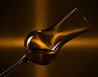 Glass with liquor Stock Photography