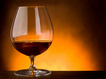 Glass  of liquor on wood table Stock Photo