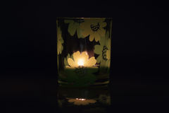 A glass. With a lit candle Royalty Free Stock Photography