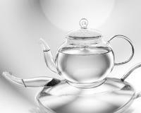 glass ljus teapot för tom afton arkivbilder