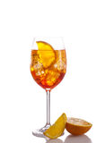 Glass of long drink, isolated on white background. Glass of exotic drink, wine-based; mixed drink with aperol, prossecco wine, soda and ice Stock Photos