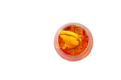 Glass of long drink. Wine-based long drink with aperol, soda, ice and orange slices, isolated on white Royalty Free Stock Photo