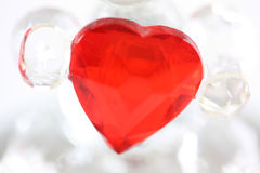 Glass love heart. Held in the arms of a glass teddy bear royalty free stock photo