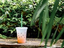Glass of lychee soda. With tree background Stock Photo