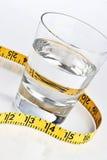glass måttbandvatten arkivfoton