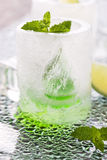 Glass made of ice with vodka, lemon and mint Stock Image