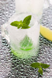 Glass made of ice with vodka, lemon and mint Royalty Free Stock Image