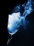 Glass of magical smoke Stock Photos
