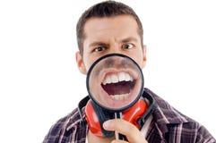 glass magnifying male showing teeth Στοκ Εικόνα