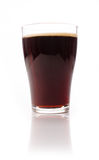 Glass of malt beer. On a white studio background Stock Image