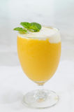 Glass of mango juice Royalty Free Stock Photo