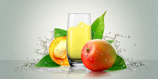 A glass of mango juice with mango fruit. Stock Photos