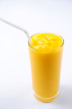 Glass of mango juice shot Stock Photo