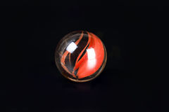 Glass marble ball. On black background spear toy Stock Image