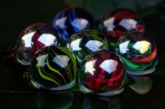 The glass Marble Ball. The close-up of glass Marble Ball of different color in arrangement Stock Photography
