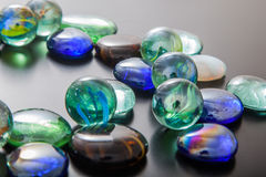 Glass marble balls and glass pebbles Royalty Free Stock Photo