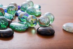 Glass marble balls and glass pebbles Stock Photos