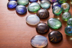 Glass marble balls and glass pebbles Stock Photography